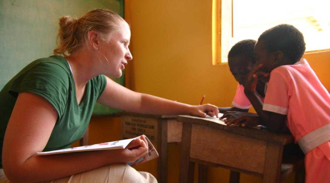 A Projects Abroad volunteer doing a speech therapy internship in Ghana works with a couple of girls.